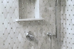 Marble water jet mosaics with crystal inlays
